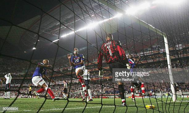 Thierry Henry David Treseguet and Sylvain Wiltord of France celebrate Zinedin Zidane's first goal as David James of England kicks the ball away...