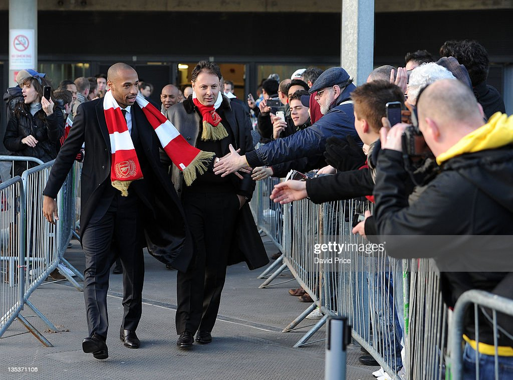 <a gi-track='captionPersonalityLinkClicked' href=/galleries/search?phrase=Thierry+Henry&family=editorial&specificpeople=167275 ng-click='$event.stopPropagation()'>Thierry Henry</a> former Arsenal player and Darren Dein at the unveilling of his Statue at Emirates Stadium, one of three iconic statues to be placed at the Emirates Stadium home of Arsenal Football Club, on December 9, 2011 in London, England.