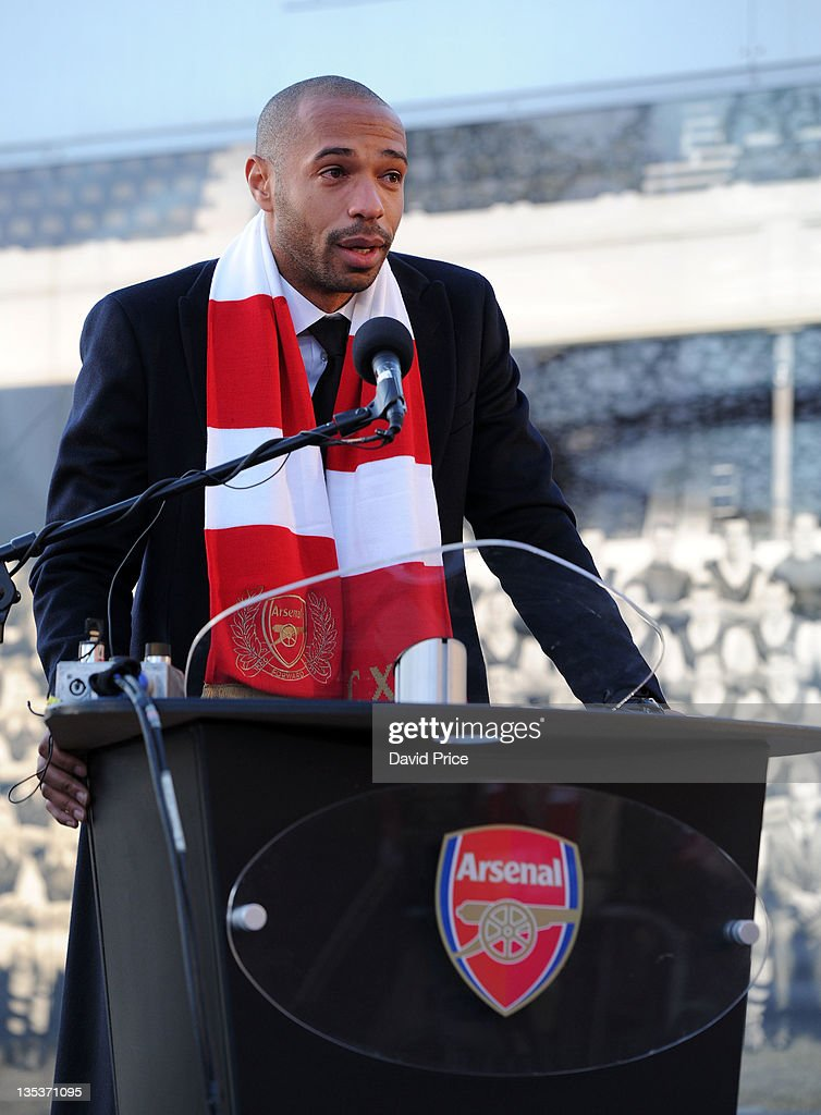 <a gi-track='captionPersonalityLinkClicked' href=/galleries/search?phrase=Thierry+Henry&family=editorial&specificpeople=167275 ng-click='$event.stopPropagation()'>Thierry Henry</a> former Arsenal player speaks at the unveilling of his Statue at Emirates Stadium, one of three iconic statues to be placed at the Emirates Stadium home of Arsenal Football Club, on December 9, 2011 in London, England.