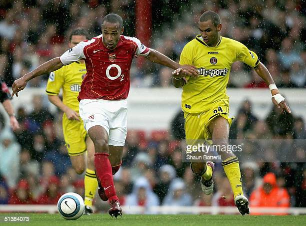 Thierry Henry of Arsenal battles with Jonathan Fortune of Charlton Athletic during the Barclays Premiership match between Arsenal and Charlton...
