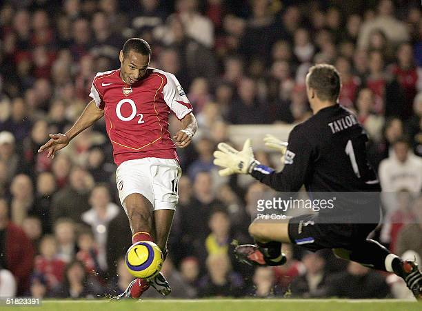 Thierry Henry of Arsenal beats Maik Taylor of Birmingham City to score Arsenals second goal during the Barclays Premiership match between Arsenal and...