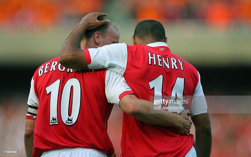 Thierry Henry of Arsenal celebrates scoring against Ajax with teammate Dennis Bergkamp during a pre season 'Dennis Bergkamp' testimonial match at...