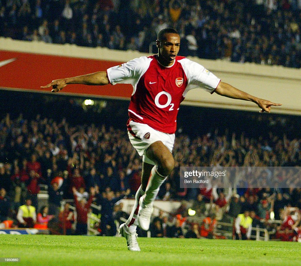 Thierry Henry of Arsenal celebrates scoring Arsenal's second goal during the FA Barclaycard Premiership match between Arsenal and Manchester United held on April 16, 2003 at Highbury in London, England. The match ended in a 2-2 draw.