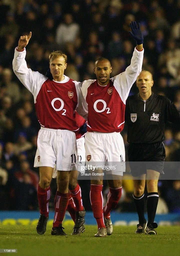 Thierry Henry of Arsenal celebrates scoring his 100th goal for Arsenal with Dennis Bergkamp of Arsenal during the FA Barclaycard Premiership match...