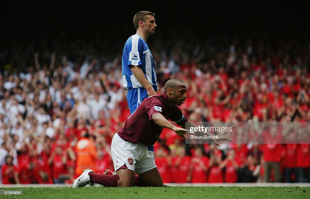 Thierry Henry of Arsenal celebrates scoring his teams fourth goal by bowing to the North Bank fans during the Barclays Premiership match between...