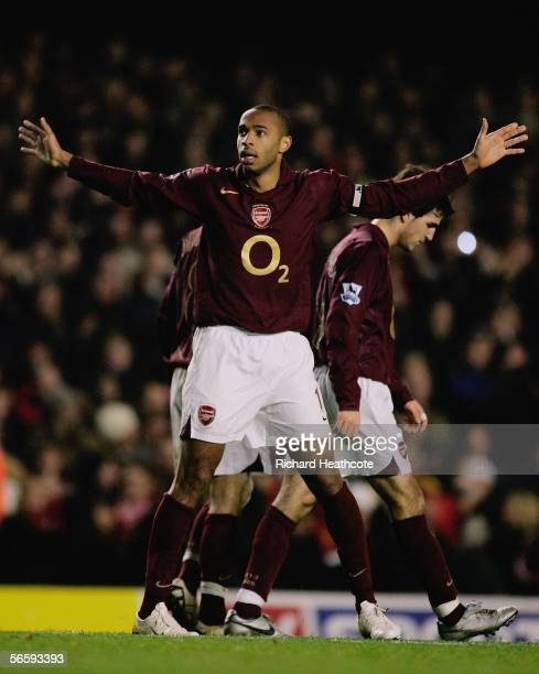 Thierry Henry of Arsenal celebrates scoring his third and the team's sixth goal of the game during the Barclays Premiership match between Arsenal and...