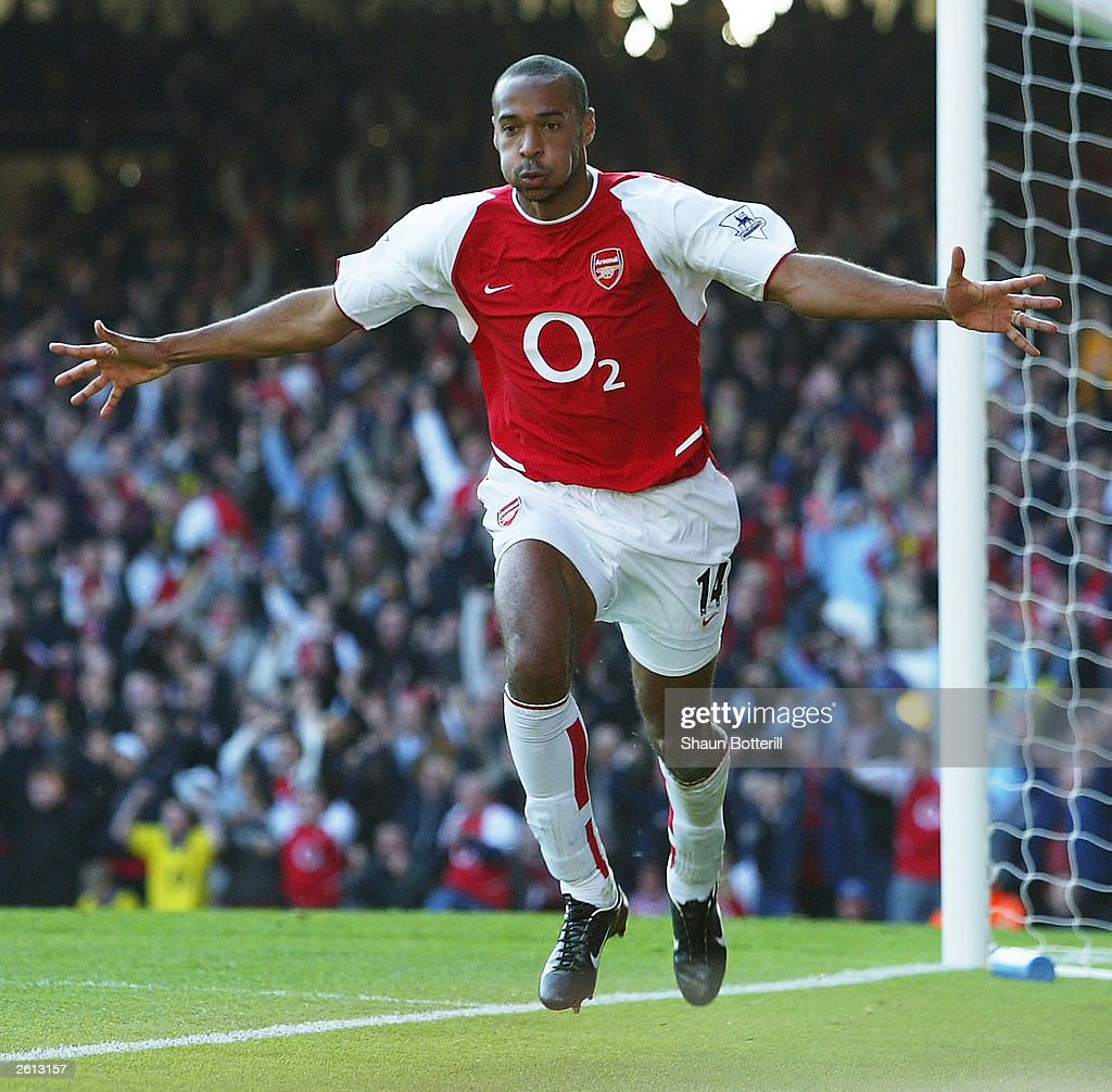 Thierry Henry of Arsenal celebrates scoring the second goal