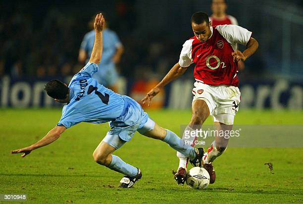 Thierry Henry of Arsenal gets away from Juan Velasco of Celta Vigo during the UEFA Champions League match between Celta Vigo and Arsenal at Balaidos...