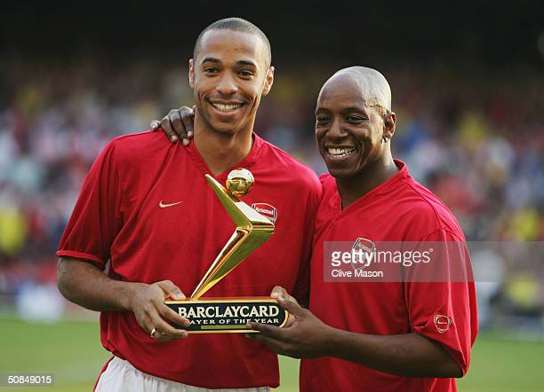 Thierry Henry of Arsenal is presented with his Barclaycard Premiership Player of the Year Award by Ian Wright during the Martin Keown Testimonial...