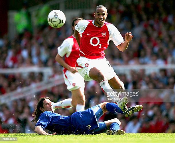 Thierry Henry of Arsenal jumps a tackle by Lilian Nalis of Leicester City during the FA Barclaycard Premiership match between Arsenal and Leicester...