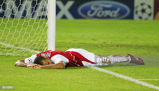 Thierry Henry of Arsenal lays on the ground after his shot goes wide during the UEFA Champions League match between Celta Vigo and Arsenal at...