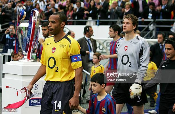 Thierry Henry of Arsenal leads out Jens Lehmann and the rest of the Arsenal team before the UEFA Champions League Final between Arsenal and Barcelona...