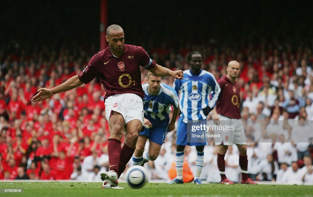 Thierry Henry of Arsenal scores his teams fourth goal from the penalty spot during the Barclays Premiership match between Arsenal and Wigan Athletic...