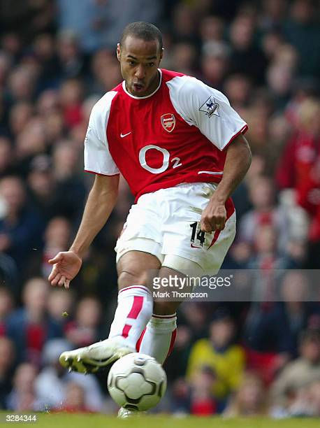 Thierry Henry of Arsenal scores the third goal for Arsenall during the FA Barclaycard Premiership match between Arsenal and Liverpool at Highbury on...