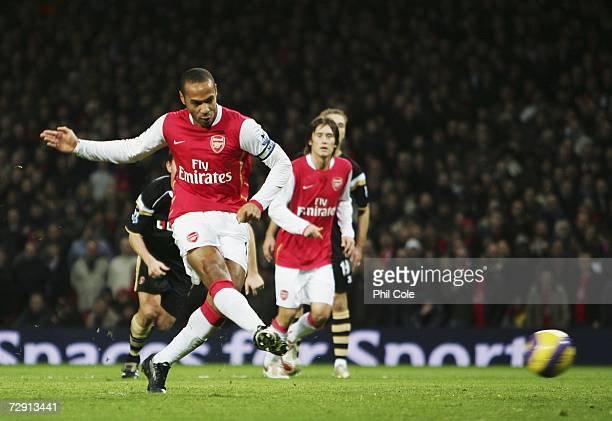 Thierry Henry of Arsenal scores their first goal from the penalty spot during the Barclays Premiership match between Arsenal and Charlton Athletic at...