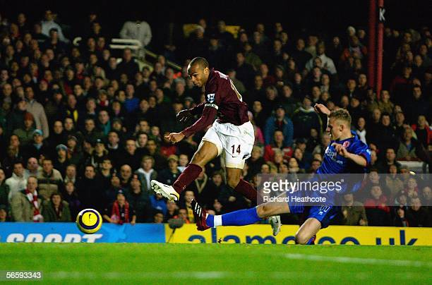 Thierry Henry of Arsenal shoots and scores his third and the team's sixth goal of the game during the Barclays Premiership match between Arsenal and...