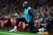 Thierry Henry of Arsenal warms up on the touchline during the FA Cup Third Round match between Arsenal and Leeds United at the Emirates Stadium on...