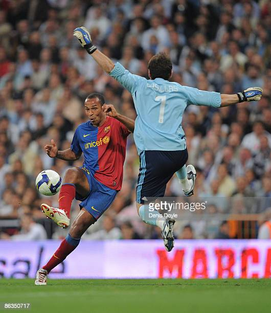 Thierry Henry of Barcelona beats Iker Casillas of Real Madrid to score Barcelona's fourth goal during the La Liga match between Real Madrid and...
