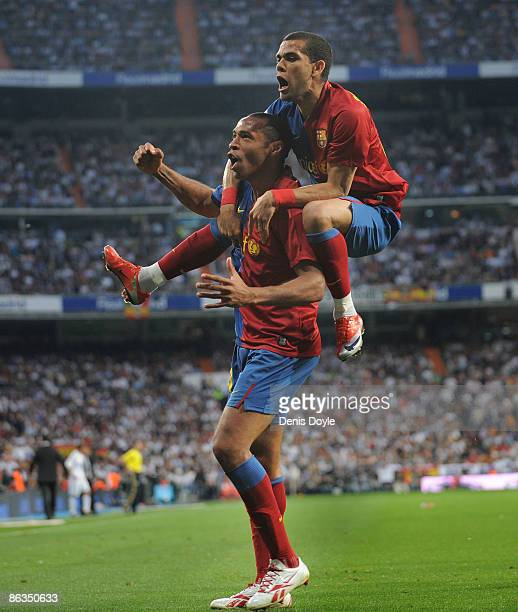 Thierry Henry of Barcelona celebrates with Dani Alves after scoring Barcelona's fourth goal during the La Liga match between Real Madrid and...