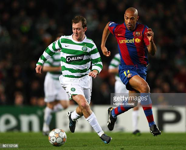 Thierry Henry of Barcelona chases Aiden McGeady of Celtic during the UEFA Champions League 2nd leg of the First knockout round match between FC...