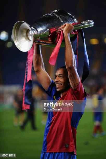 Thierry Henry of Barcelona lifts the trophy as he celebrates winning the UEFA Champions League Final match between Manchester United and Barcelona at...