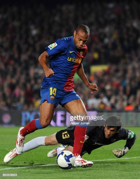 Thierry Henry of Barcelona scores his sides third goal past goalkeeper Inaki Goitia of Malaga during the La Liga match between Barcelona and Malaga...