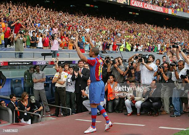 Thierry Henry of France applauds Barca fans at the Camp Nou stadium after signing for Barcelona on June 25 2007 in Barcelona Spain