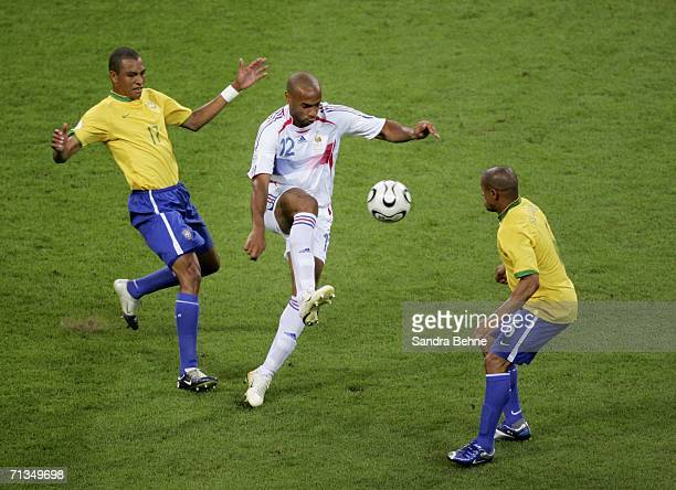 Thierry Henry of France controls the ball under pressure from Gilberto Silva and Roberto Carlos of Brazil during the FIFA World Cup Germany 2006...