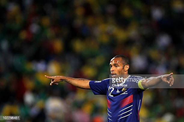Thierry Henry of France gestures to team mates during the 2010 FIFA World Cup South Africa Group A match between France and South Africa at the Free...