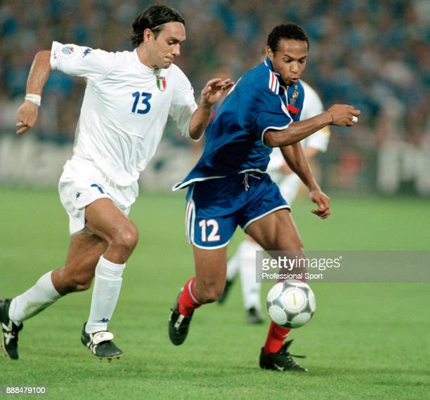 Thierry Henry of France holds off Alessandro Nesta of Italy during the UEFA Euro 2000 Final at the Feijenoord Stadium on July 02 2000 in Rotterdam...