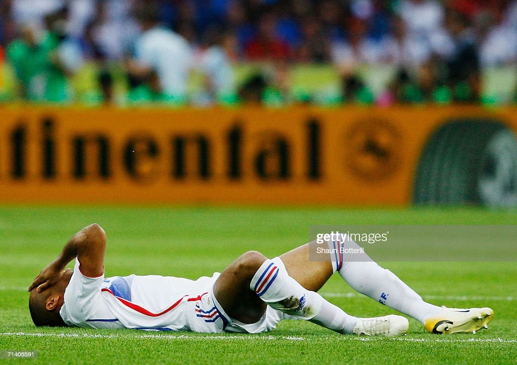 Thierry Henry of France lies injured on pitch during the FIFA World Cup Germany 2006 Final match between Italy and France at the Olympic Stadium on July 9, 2006 in Berlin, Germany.
