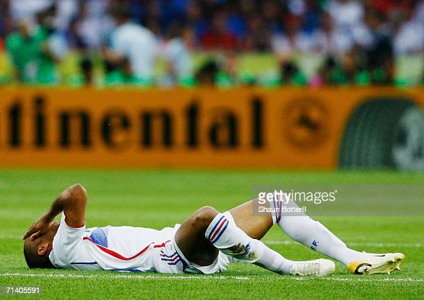 Thierry Henry of France lies injured on pitch during the FIFA World Cup Germany 2006 Final match between Italy and France at the Olympic Stadium on...