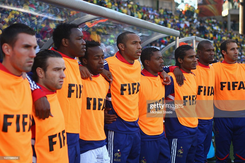Thierry Henry (c)of France lines up during the national anthem alongside Sidney Govou (4th l), Patrice Evra (4th r) and Florent Malouda (3rd r) during the 2010 FIFA World Cup South Africa Group A match between France and South Africa at the Free State Stadium on June 22, 2010 in Mangaung/Bloemfontein, South Africa.