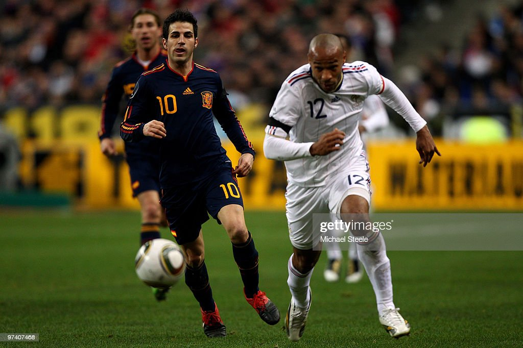 Thierry Henry (R) of France races away from Cesc Fabregas (L) during the France v Spain International Friendly match at the Stade de France on March 3, 2010 in Paris, France.