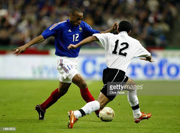 Thierry Henry of France takes on Ahmed Fathy of Egypt during the International friendly match between France and Egypt on April 30 2003 at The Stade...