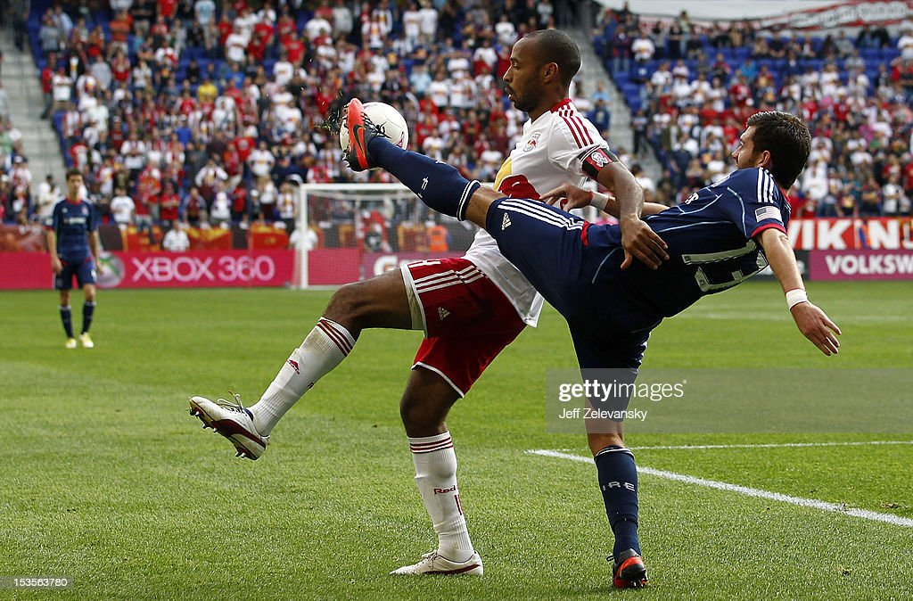 Thierry Henry of New York Red Bulls and Gonzalo Segares of Chicago Fire fight for the ball during their match at Red Bull Arena on October 6 2012 in...