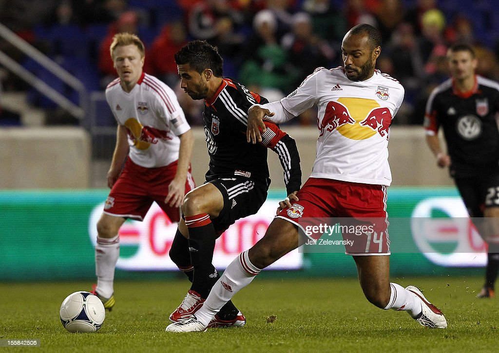 <a gi-track='captionPersonalityLinkClicked' href=/galleries/search?phrase=Thierry+Henry&family=editorial&specificpeople=167275 ng-click='$event.stopPropagation()'>Thierry Henry</a> #14 of New York Red Bulls and <a gi-track='captionPersonalityLinkClicked' href=/galleries/search?phrase=Marcelo+Saragosa&family=editorial&specificpeople=178311 ng-click='$event.stopPropagation()'>Marcelo Saragosa</a> #11 of D.C. United fight for the ball in their Eastern Conference Semifinal match at Red Bull Arena on November 8, 2012 in Harrison, New Jersey.