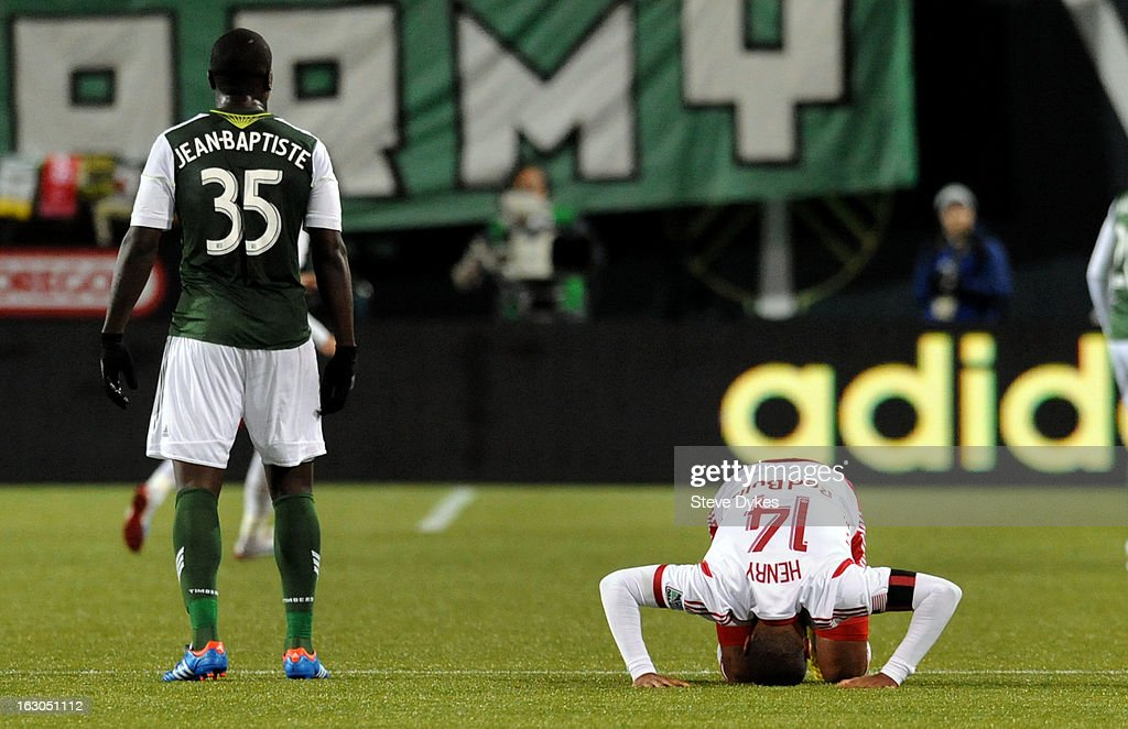 Thierry Henry #14 of New York Red Bulls falls to the turf as Andrew Jean-Baptiste #35 of Portland Timbers looks on during the second half of the game at Jeld-Wen Field on March 03, 2013 in Portland, Oregon. The game ended in a 3-3 draw.