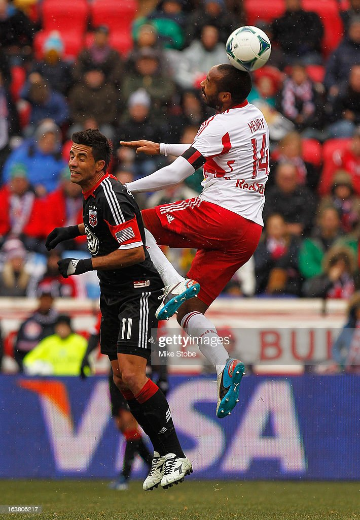 <a gi-track='captionPersonalityLinkClicked' href=/galleries/search?phrase=Thierry+Henry&family=editorial&specificpeople=167275 ng-click='$event.stopPropagation()'>Thierry Henry</a> #14 of New York Red Bulls heads the ball in front of <a gi-track='captionPersonalityLinkClicked' href=/galleries/search?phrase=Marcelo+Saragosa&family=editorial&specificpeople=178311 ng-click='$event.stopPropagation()'>Marcelo Saragosa</a> #11 of D.C. United at Red Bull Arena on March 16, 2013 in Harrison, New Jersey. Red Bulls and DC United play to a 0-0 draw.