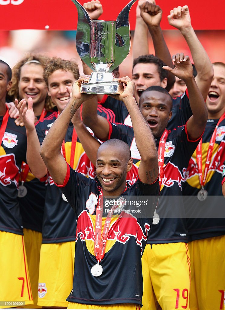 Thierry Henry of New York Red Bulls lifts the Emirates Cup after the match between Arsenal and New York Red Bulls at the Emirates Stadium on July 31...