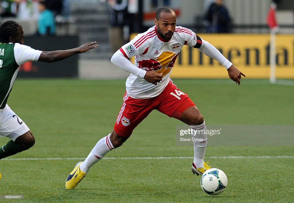 <a gi-track='captionPersonalityLinkClicked' href=/galleries/search?phrase=Thierry+Henry&family=editorial&specificpeople=167275 ng-click='$event.stopPropagation()'>Thierry Henry</a> #14 of New York Red Bulls moves around Diego Chara #21 of Portland Timbers during the first half of the game at Jeld-Wen Field on March 03, 2013 in Portland, Oregon.