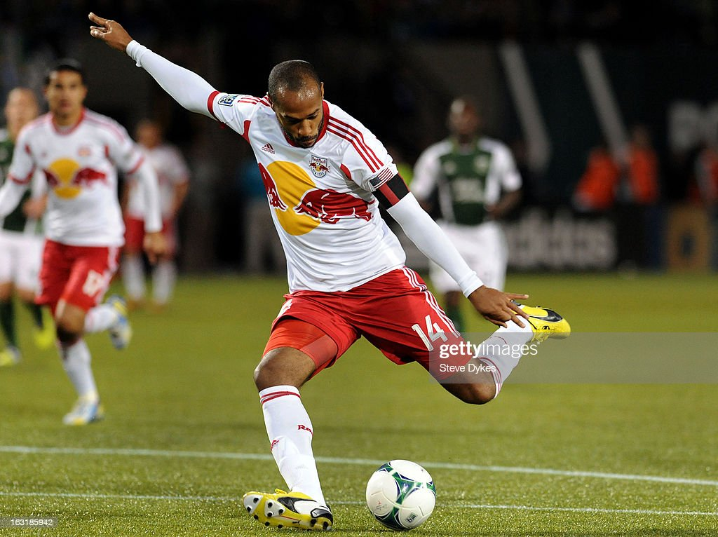 <a gi-track='captionPersonalityLinkClicked' href=/galleries/search?phrase=Thierry+Henry&family=editorial&specificpeople=167275 ng-click='$event.stopPropagation()'>Thierry Henry</a> #14 of New York Red Bulls puts a shot on goal during the second half of the game against the Portland Timbers at Jeld-Wen Field on March 03, 2013 in Portland, Oregon. The game ended in a 3-3 draw.