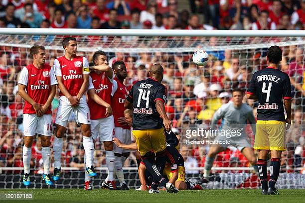Thierry Henry of New York Red Bulls takes a free kick during the Emirates Cup match between Arsenal and New York Red Bulls at the Emirates Stadium on...