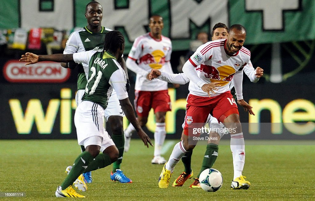 <a gi-track='captionPersonalityLinkClicked' href=/galleries/search?phrase=Thierry+Henry&family=editorial&specificpeople=167275 ng-click='$event.stopPropagation()'>Thierry Henry</a> #14 of New York Red Bulls works his way up the field as Diego Chara #21 of Portland Timbers closes in during the second half of the game at Jeld-Wen Field on March 03, 2013 in Portland, Oregon. The game ended in a 3-3 draw.