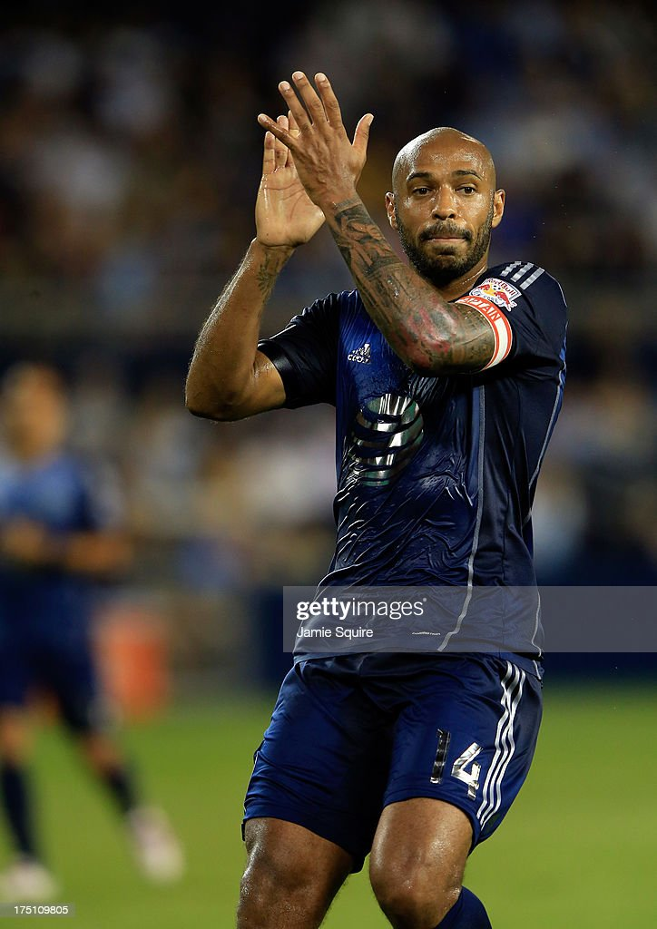 <a gi-track='captionPersonalityLinkClicked' href=/galleries/search?phrase=Thierry+Henry&family=editorial&specificpeople=167275 ng-click='$event.stopPropagation()'>Thierry Henry</a> #14 of the MLS All-Stars applauds after a favorable call during the 2013 Major League Soccer All Star Game against AS Roma at Sporting Park on July 31, 2013 in Kansas City, Kansas.