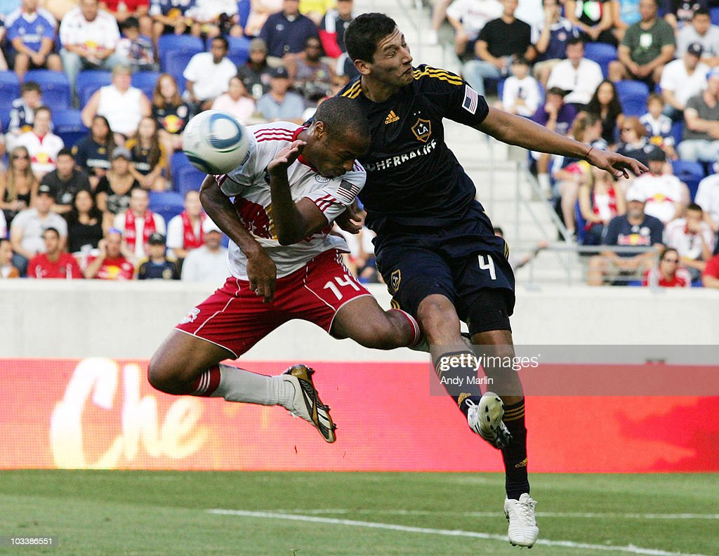 Thierry Henry #14 of the New York Red Bulls and Omar Gonzales #4 of the Los Angeles Galaxy battle hard for a loose ball during their game at Red Bull Arena on August 14, 2010 in Harrison, New Jersey.