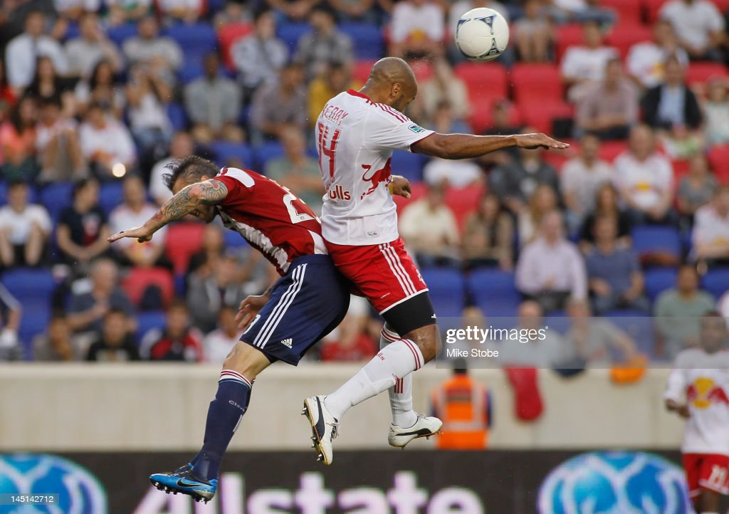 Thierry Henry of the New York Red Bulls heads the ball over Danny Califf of the Chivas USA at Red Bull Arena on May 23 2012 in Harrison New Jersey...