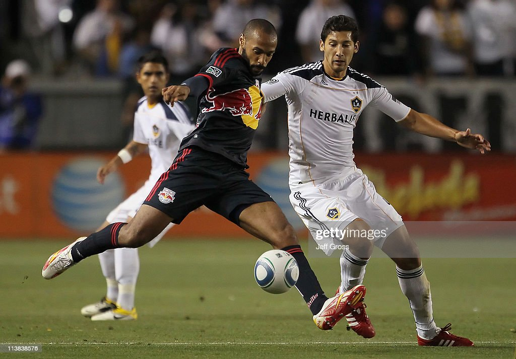 <a gi-track='captionPersonalityLinkClicked' href=/galleries/search?phrase=Thierry+Henry&family=editorial&specificpeople=167275 ng-click='$event.stopPropagation()'>Thierry Henry</a> #14 of the New York Red Bulls is challenged by <a gi-track='captionPersonalityLinkClicked' href=/galleries/search?phrase=Omar+Gonzalez&family=editorial&specificpeople=2488485 ng-click='$event.stopPropagation()'>Omar Gonzalez</a> #4 of the Los Angeles Galaxy for the ball in the second half at The Home Depot Center on May 7, 2011 in Carson, California. The Red Bulls and Galaxy played to a 1-1 draw.