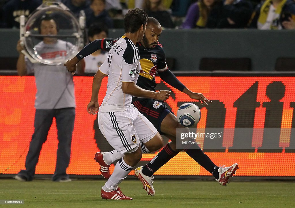 <a gi-track='captionPersonalityLinkClicked' href=/galleries/search?phrase=Thierry+Henry&family=editorial&specificpeople=167275 ng-click='$event.stopPropagation()'>Thierry Henry</a> #14 of the New York Red Bulls is challenged by <a gi-track='captionPersonalityLinkClicked' href=/galleries/search?phrase=Omar+Gonzalez&family=editorial&specificpeople=2488485 ng-click='$event.stopPropagation()'>Omar Gonzalez</a> #4 of the Los Angeles Galaxy for the ball in the first half at The Home Depot Center on May 7, 2011 in Carson, California. The Red Bulls and Galaxy played to a 1-1 draw.