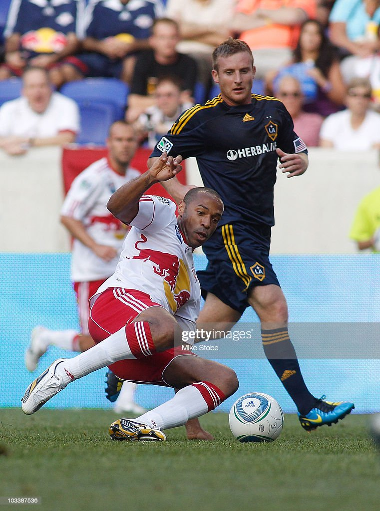 Thierry Henry #14 of the New York Red Bulls plays the ball against Chris Birchall #11 of the Los Angeles Galaxy on August 14, 2010 at Red Bull Arena in Harrison, New Jersey. Galaxy defeat the Red Bulls 1-0.